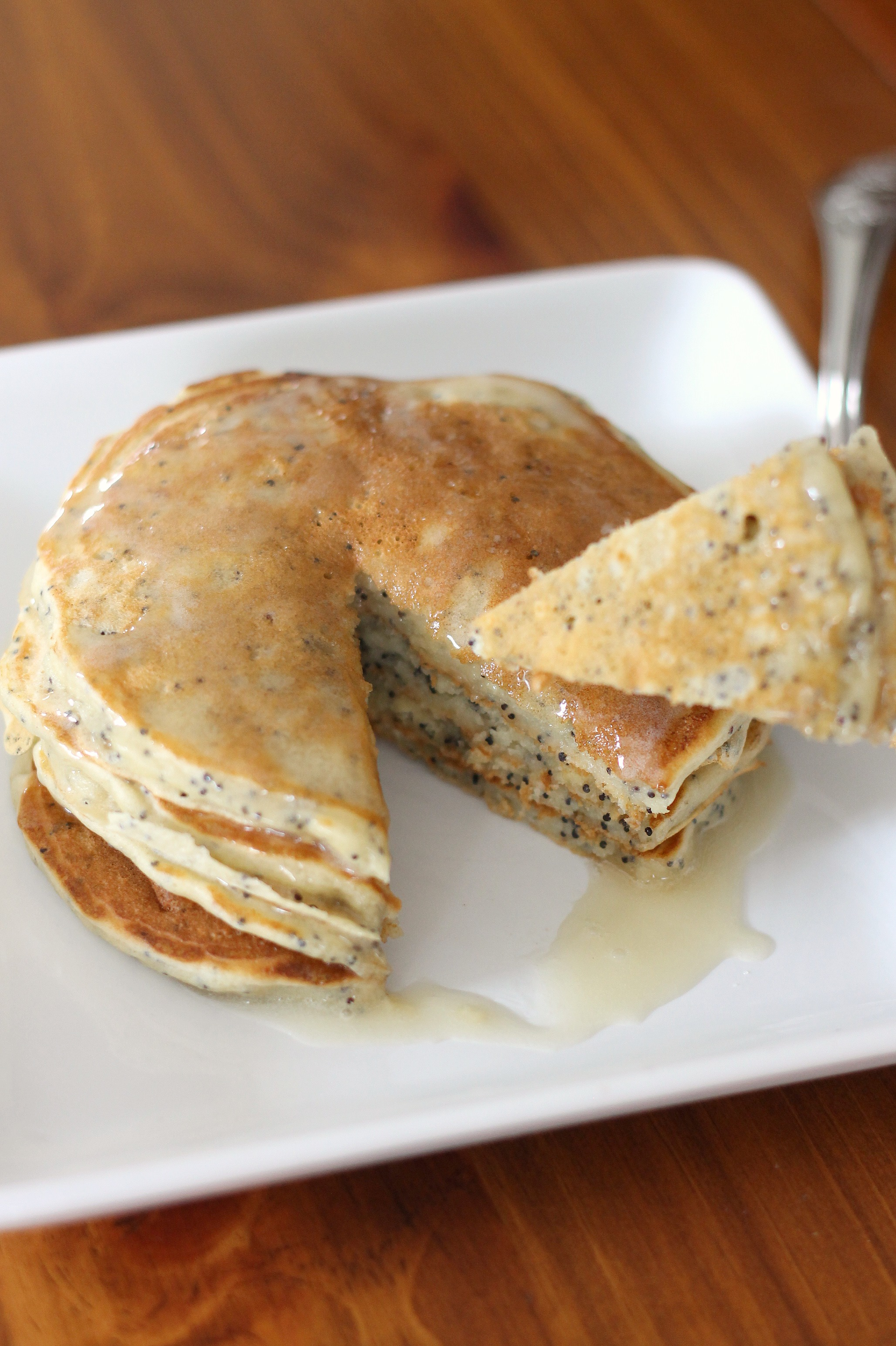 Almond Poppy Seed Pancakes with Almond Cream Sauce | We Like Two Cook